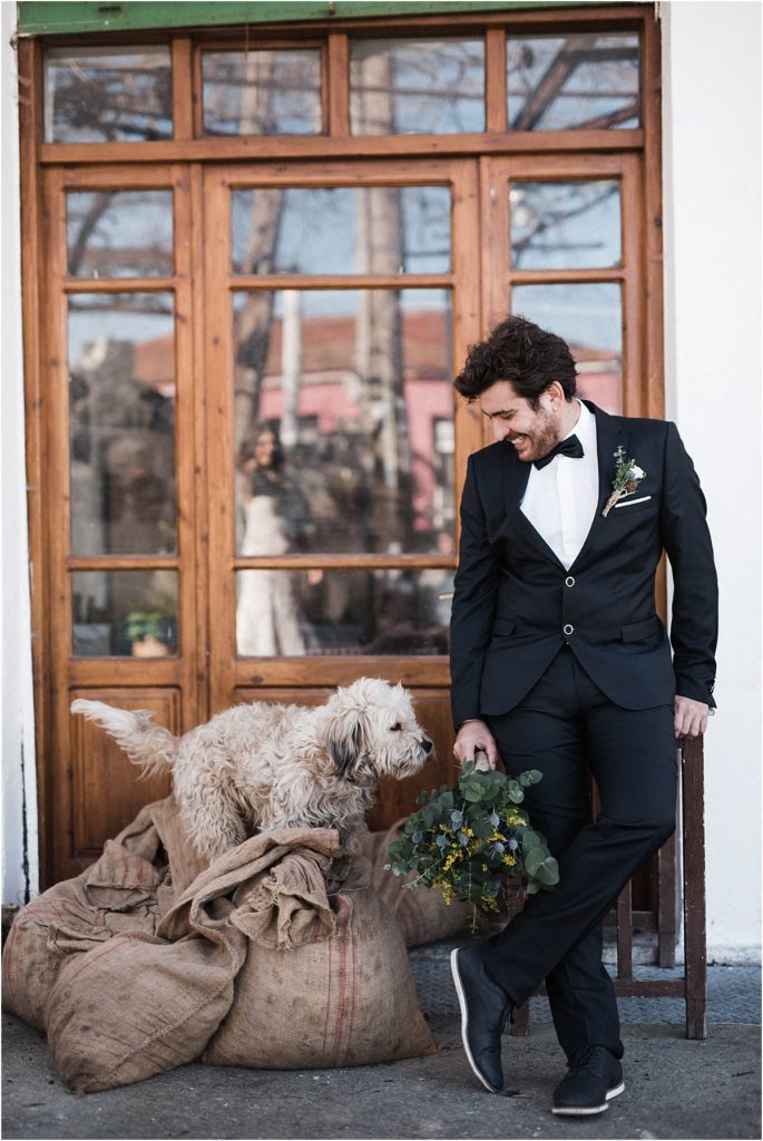 Groom with floral bouquet and dog